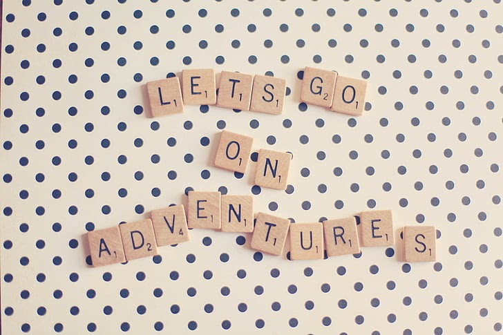 scrabble tiles spell: LETS GO ON ADVENTURES
