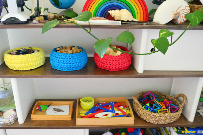 shelves with colorful baskets and toys